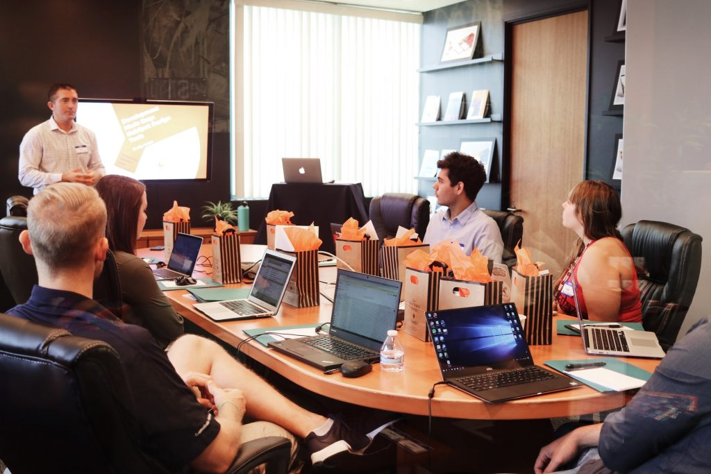 Developers discussing about PHP web development.
